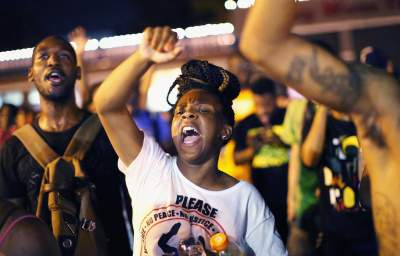 Is Ferguson Feeding on the Poor? City Disproportionately Stops, Charges and Fines People of Color