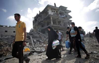 During Brief Lull, Gazans Return to Neighborhoods Destroyed and Bodies Beneath the Rubble