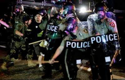 The Brutal Slaying of Michael Brown and a Police State in Ferguson, MO
