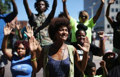 """Protests Against Police Brutality: """"Hands Up, Don't Shoot"""""""