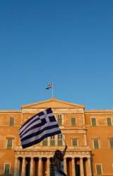 Greek Law Approves Civil Servant Cuts