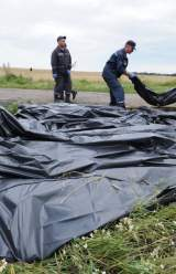 Ukraine Rebels Remove Bodies from Recent Crash Site
